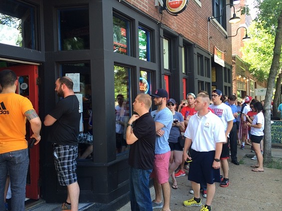 The beginning of the line at the Amsterdam Tavern for the first U.S. World Cup game. - LINDSAY TOLER