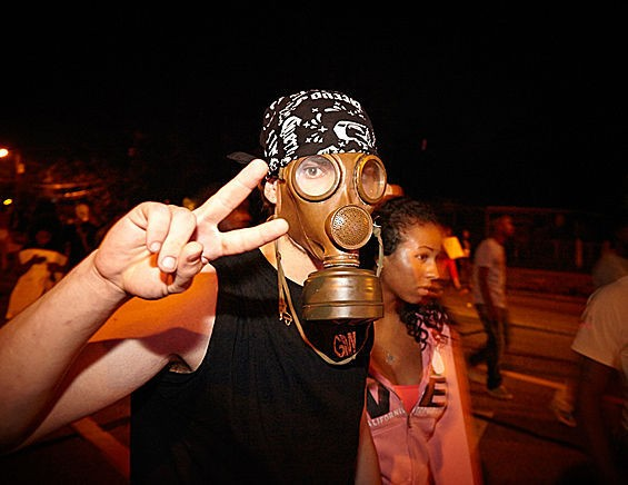 A demonstrator protects his face from tear gas in Ferguson. - STEVE TRUESDELL