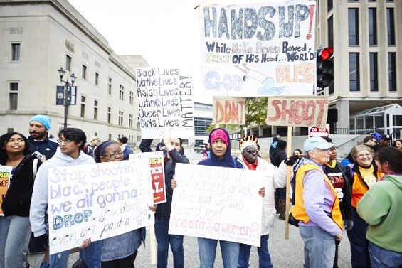 Protesters brought handmade and printed signs to the Ferguson October protest march on Saturday, October 11, in downtown St. Louis. - ALL PHOTOS BY THEO WELLING