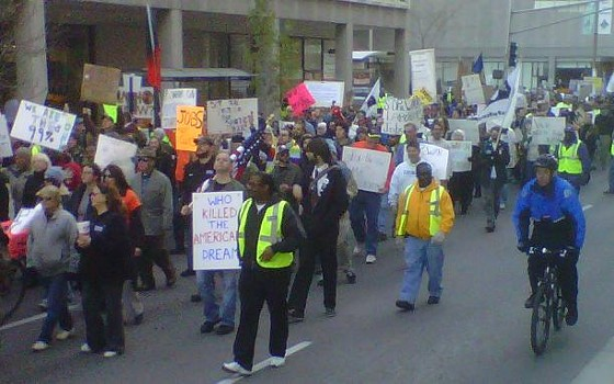 Occupy STL protesters march to the MLK Bridge yesterday afternoon. - PHOTOS: TONY D'SOUZA