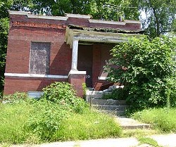 A vacant home in the Wells Goodfellow neighborhood for sale through the city's Land Reutilization Authority.