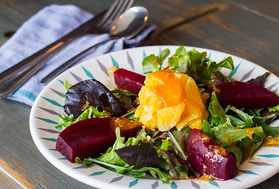 """""""Purple Beet and Orange Salad"""" with arugula and a North African vinaigrette seasoned with cumin, cinnamon, honey and lemon. 