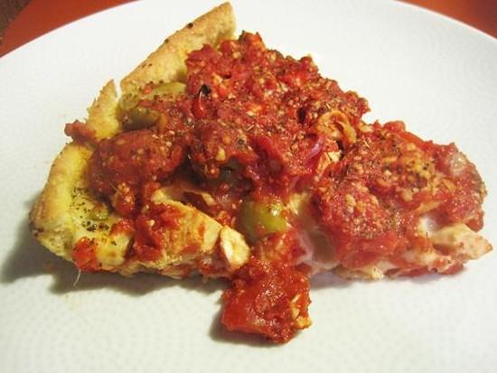 "A slice of Pi Pizzeria's ""Bucktown"" pizza - IAN FROEB"