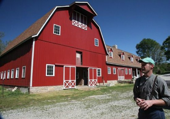 Steve Baetje in front of the barn that serves as his cheese making headquarters. - BETH FARROW CLAUSS