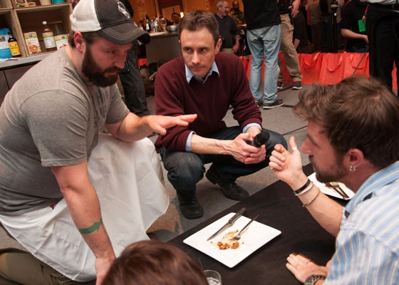 Chef Ed Heath, with RFT editor-in-chief Chad Garrison, presents his dish to the judges at Iron Fork 2014. | Micah Usher