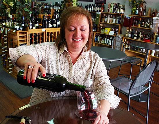 Kata Lozina inside Kaya's Import Wine & Spirits - KATIE MOULTON