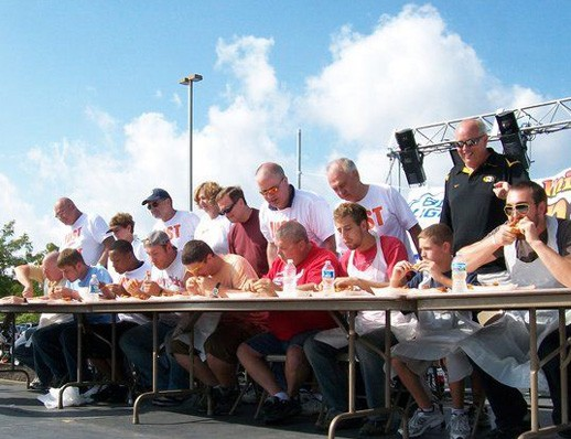 A scene from a wing-eating contest at last year's Midwest Wingfest. - IMAGE VIA