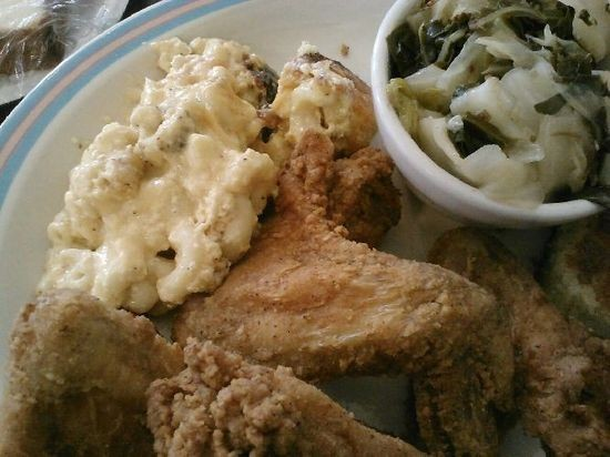 Chicken wings with mac & cheese and cabbage at Sweetie Pie's at the Mangrove - SARAH RUSNAK