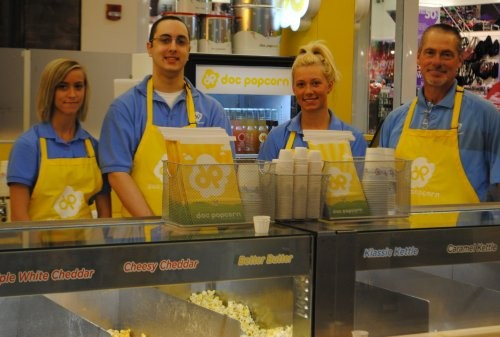 Paige Jung, Mark Viviano, and Brandy and Randy Jung stand at the Doc Popcorn kiosk in South County Center. - JULIA GABBERT