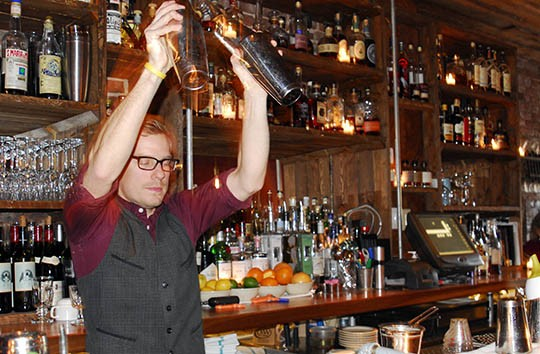 Kyle Mathis gets in the zone while shaking cocktails | Kaitlin Steinberg