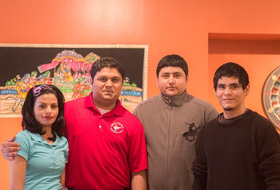 Owner Jesse Nagra (second from left) with his wife and staff.