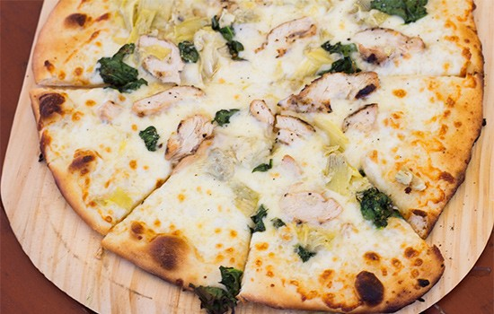 "Leonardo's ""Chic Sev"" white pizza with roasted-garlic olive oil, grilled chicken and more. 