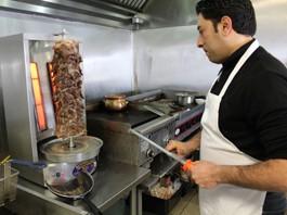 Wasem Hamed, chef and owner of Kaslik Restaurant in Florissant, prepares an order of beef shawarma. - EVAN C. JONES