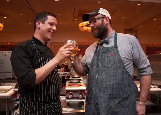 John Perkins, right, shares a beer with fellow chef Brian Coltrain. | Micah Usher