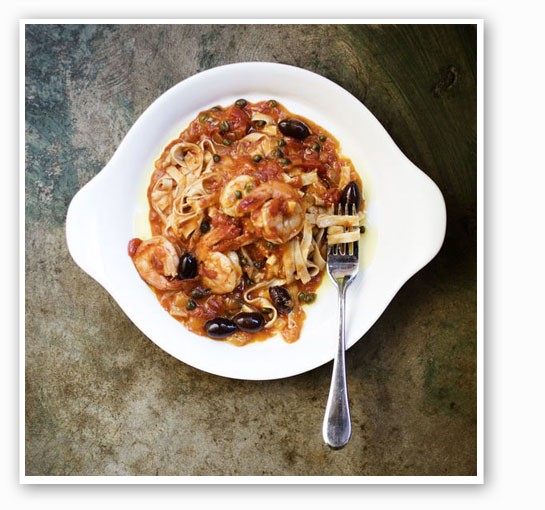 Fettuccine-Gulf Shrimp is served with fresh pasta, olives, capers, basil, chiles and tomato.   Jennifer Silverberg