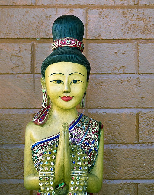 "It is customary in Thai culture to greet guests upon entering and exiting with hands together, a nod of the head and the word ""soawadee."" Owner and executive chef Scott Truong and his brother Tommy made sure to place a figure facing in, and another facing out, so whenever entering or exiting Pearl Café you are met with a lovely statue and an implied ""soawadee."" See a photo slideshow here. - PHOTO: JENNIFER SILVERBERG"