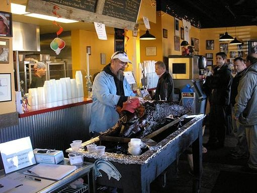 Mike Emerson serving whole-hog barbecue at Pappy's Smokehouse in February. - IAN FROEB