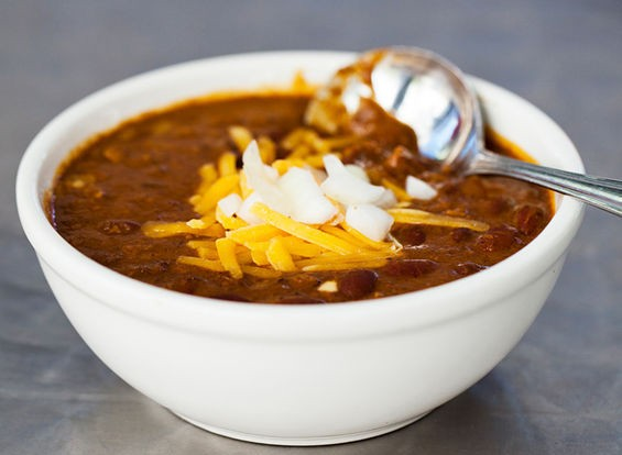 A simple bowl of chili with cheddar cheese and onions from Joe's Chili Bowl. | Jennifer Silverberg