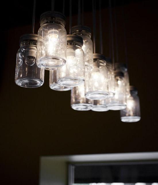 Mason jar light fixtures illuminate Clayton's Crushed Red. - JENNIFER SILVERBERG
