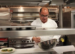 Chef David Zimmerman preparing hollandaise in the Plush kitchen. - MABEL SUEN