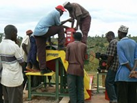Farmers being trained on the Penagos machine - PHOTO COURTESY SUSTAINABLE HARVEST STAFF