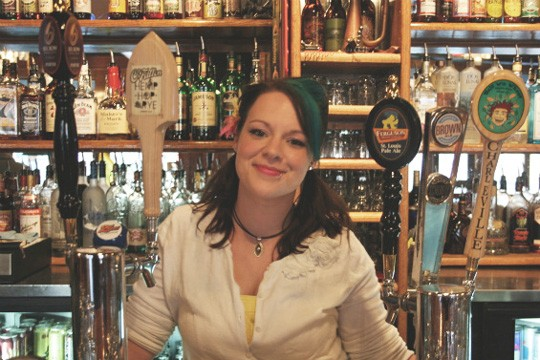 Keeley McGrew poses proudly between two rows of strictly St. Louis taps. - CHRISSY WILMES