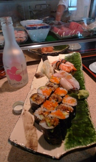 Salmon Avocado Roll, Eel Avocado Roll and pieces of Salmon, Red Snapper and Yellowtail nigiri.