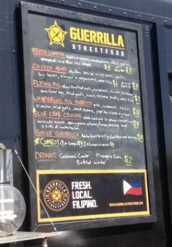 The menu at Guerrilla Street Food. - EVAN C. JONES