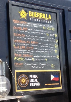 The menu at Guerrilla Street Food. - EVAN C. JONES
