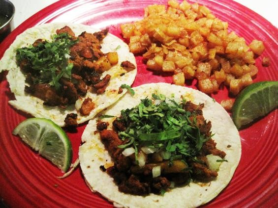 Tacos al pastor, with a side of papas picositas, at Señoritas Pique - IAN FROEB
