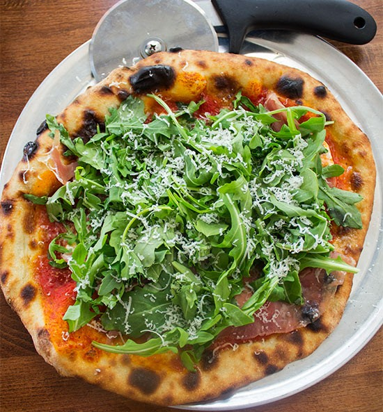"""Fantasy"" pizza with tomato sauce, prosciutto de parma, fresh burrata and arugula. 