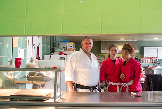 Director Loren Copp with volunteers Lorraine Bala and Nashayla Acres in the kitchen.