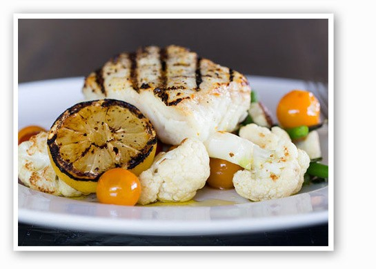 Wood-grilled halibut with green beans, cauliflower, lemon, oregano, tomato and olive oil at Prasino. | Jennifer Silverberg