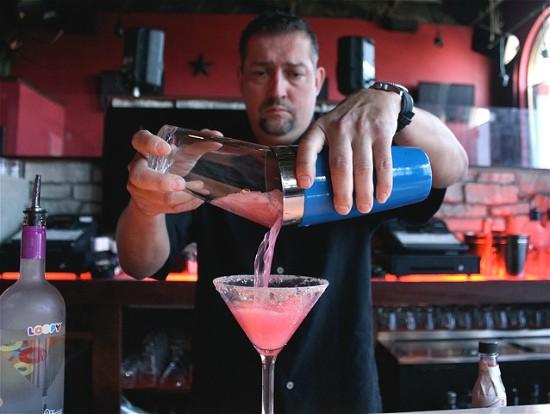 """Bradon Parsons pours a """"Let's Get Looped"""" martini. - ALEXIS HITT"""