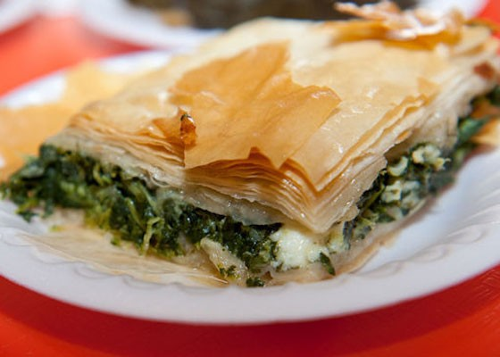 Spanakopita, spinach pie with chopped spinach and feta cheese layered in phyllo dough. | Jon Gitchoff