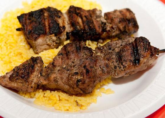 Souvlaki, pork loin kebobs with rice. | Jon Gitchoff
