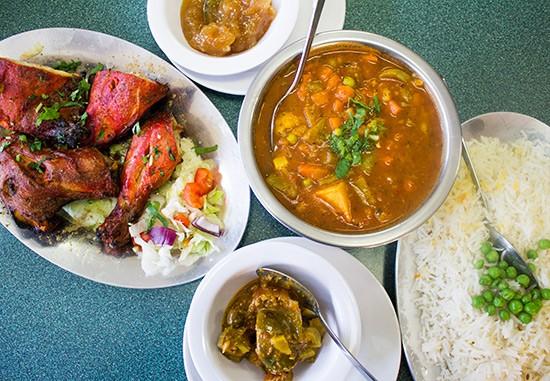 Chicken tandoori, vegetable vindaloo, mango chutney and spicy Indian pickles. | Photos by Mabel Suen