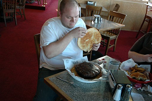 Abegg uncovers his meat at the Sunset Hills Fuddruckers on a truly Fat Tuesday, February 16. - PHOTO: ANDREW MARK VEETY