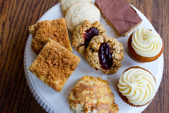 Gluten-free crumb cake, gluten-free sugar cookies, vegan jam thumbprint cookies, a peanut butter choclate bar, pumpkin cupcakes with cream cheese frosting and a maple oat scone. - MABEL SUEN
