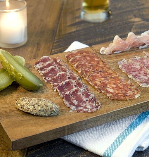 The charcuterie small plate is heart salami, Hungarian salami, saddle ham and saucisson sec -- all house-made with meat from supplied from Farrar Farms in Frohna, Missouri and served with mustard and pickle. See a slideshow of photos from Taste by Niche. - PHOTO: JENNIFER SILVERBERG