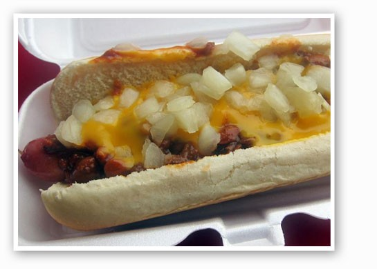 The Chili Dog: all-beef hot dog topped with chili, melted cheddar cheese and chopped onions. |        Dog'n It