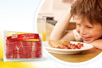 Here's a kid absolutely in love with bacon. Just look at him. - IMAGE SOURCE