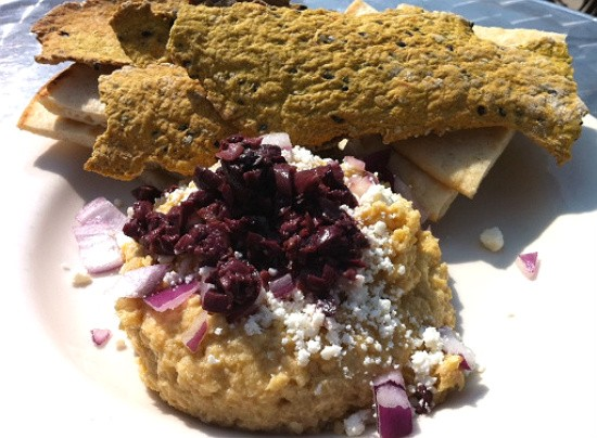 The hummus appetizer replete with feta, kalamata olives, red onions, curry crackers and flatbread. - RFT PHOTO