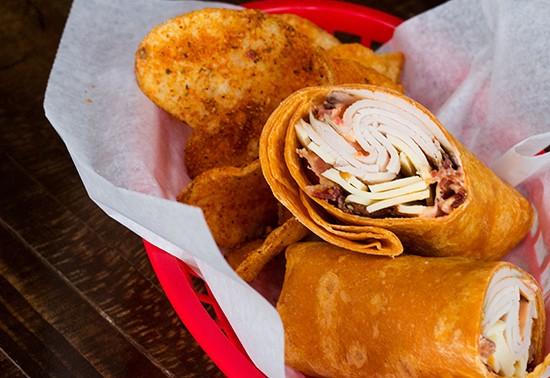 """Sea Salt Turkey"" wrap with seasoned chips. - PHOTOS BY MABEL SUEN"