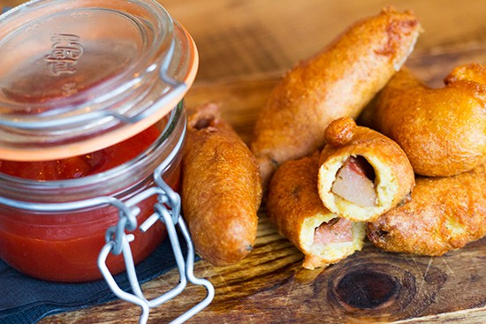 Andouille corn dogs with spicy ketchup.