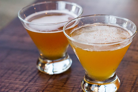 """Signature cocktails: """"Honey Island"""" ($10) with hazelnut- and vanilla-infused Dewar's Honey scotch whiskey and """"Peachy Keen"""" ($10) with Buffalo Trace bourbon, fresh peach and cinnamon. - ALL PHOTOS BY MABEL SUEN"""