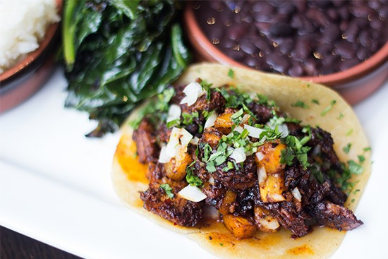 """Asada"" taco with beef brisket, onion and seasonal salsa. 