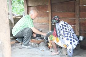 Shawn Askinosie (left) teaches a Tanzanian farmer how to roast cocoa beans. - ASKINOSIE CHOCOLATE