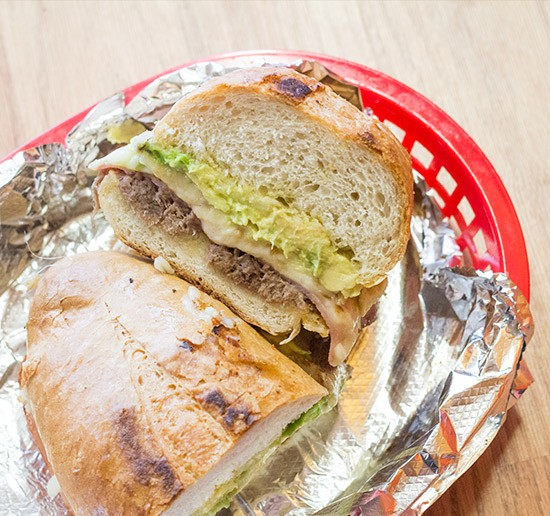 """Torta Special"" with shredded beef, melted cheese, ham and avocado. 
