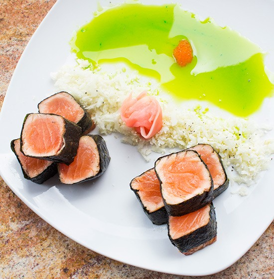 """""""Nori Wrapped Salmon"""" with cauliflower rice, wasabi honey glaze and pickled ginger. 